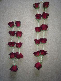 Fresh roses and pearl garlands