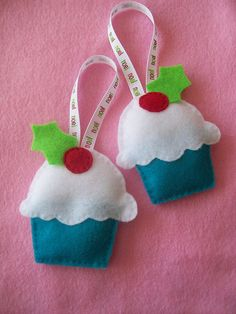 This year I'm going to make a ton of cute, simple, kid-friendly felt ornaments for the tree. Cupcakes make me happy, so this seems a good place to start.