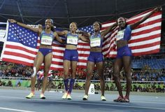 The U.S. women's 4×100 relay team celebrates after winning gold. (AP)