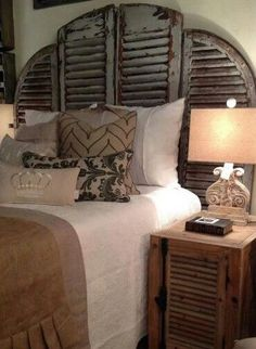 Love this distressed shutter headboard <3