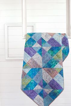 Framed Pinwheels is a beautiful, complex-looking batik quilt made easy with our easy strip set technique. Play with color and contrast for a versatile and easy quilt pattern.
