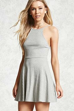 Style Deals - A ribbed knit dress featuring a crew neck, cami straps, a  cutout back, and a skater skirt.