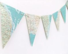 This map bunting has been up-cycled from a vintage World Atlas with gorgeous mint greens and turquoise coloured oceans. It makes fabulous wedding decor. It would also be wonderful in any room in your home to add a lovely summer feel! This listing is for ONE garland of bunting with 8 triangular flags, each 7 in x 4.5 in (17.5 cm x 11 cm). They have been threaded with rescued wool (which may be a different colour from the photos). If the flags were placed end to end on the wool, the garland…