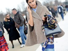 that shearling cape is just luscious. Mira in Paris. #MiroslavaDuma