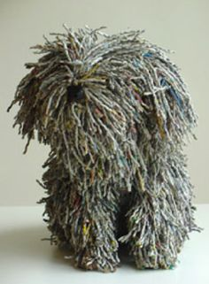 Recycled newsprint twisted into cords cleverly forms this shaggy dog.