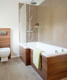Bathroom with wooden bath panel, mosaic tiles and fitted shower Shower Over Bath, Tub Shower Combo, Shower Tub, Shower Alcove, Attic Shower, Shower Rooms, Glass Shower, Bad Inspiration, Bathroom Inspiration