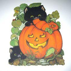 Vintage Halloween Die Cut Decoration with Black Cats Jack O Lantern and Vines by Hallmark. $6.95, via Etsy.