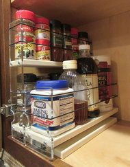 Pull out spice rack for your kitchen cabinets. Helps organize your kitchen by this innovative spice rack design.