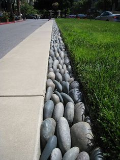 Top 50 Best River Rock Landscaping Ideas - Hardscape Designs Discover a tranquil reminder of rushing water, with the top 50 best river rock landscaping ideas. Explore backyard and front yard outdoor hardscape designs. Rock Edging, Driveway Edging, Lawn Edging, Stone Edging, Rock Border, Driveway Ideas, Sidewalk Edging, Grass Edging, Deck Edging Ideas
