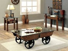 This industrial table collection offers the perfect combination of mixed-media craftsmanship. Detailed with clear 8mm tempered glass, weathered wood tones, and an eye-catching metal wagon wheel base on the coffee table. Transitional Style Fixed Wheels 8mm Tempered Glass Top Metal Chain Accents Solid Wood, Others Medium Weathered Oak Finish
