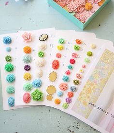 Buttons! You could crochet little flowers to make buttons...