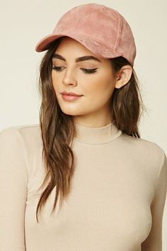 A faux suede baseball cap featuring an adjustable back.                                                                                                                                                                                 More