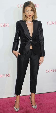 For her latest red carpet appearance, Sarah Hyland traded in the usual dress in favor of a sexy black tailored pantsuit—sans layers—that she styled with a double strand choker and white lace houndstooth Nicholas Kirkwood pumps.