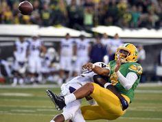DB Budda Baker takes down the Oregon QB.