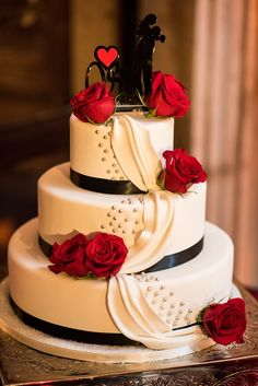 Three tier round white cake with a black sillouette cake topper and red roses | Pixel Dust Photography | villasiena.cc