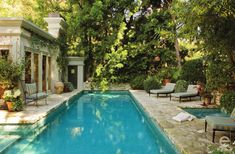 Monochromatic landscape makes pool look like its carved right out of the stone. It's small and fits perfectly but doesn't look disproportionate to backyard space.