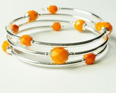 Orange Bracelet on Memory Wire Bangle Style by ReneeBrownsDesigns. , via Etsy.