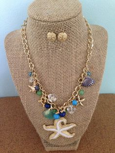 Starfish and nautical seashells and beads turn this necklace into a beautiful statement piece.
