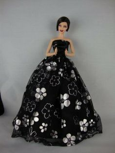 A White Strapless Dress with Black Floral Theme  Made to Fit Barbie Doll