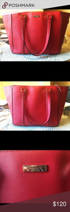 Kate Spade  Briar Newberry Lane Tote Good condition, beautiful fire engine red Tote. The outside is almost in perfect condition.   The inside does have stains from pens, even a business card stamped its way on the cloth somehow 🤷🏻♀️   No tears, rips, or broken buckles. The only flaws are in the inside of the bag, and the Kate Spade symbol on the front is scratched a bit. Open to offers! Or trades! ❤️ kate spade Bags Totes