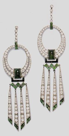 A pair of Art Deco emerald and diamond earrings, by Van Cleef & Arpels. Source: Century of Style - Art Deco Fashion and Jewelry #VanCleefArpels #ArtDeco #earrings