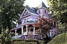 1888 Queen Anne Victorian in Atlantic Highlands, New Jersey  Whimsical in design and lovingly maintained, this picturesque house features a widow's walk, gables, turrets, verandas, balconies, decorative hand cut shingles, 9 foot ceilings, bay windows, and wainscotted walls.