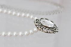 Add a brooch to a necklace for a bit of charm and to make a statement