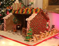 "Gingerbread house with a fireplace, ""tiled"" floor and peppermint fence"