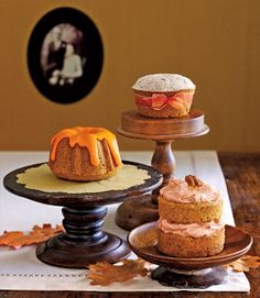 Three different pans and one pumpkin-spice recipe yield a trio of tiny cakes. Wrapped in ribbon, the sugar frosted cake is made in a muffin tin. A mini Bundt cake is dressed in a citrus glaze. The little layer cake is baked in ramekins. Recipe: Pumpkin-Spice Cake    - CountryLiving.com