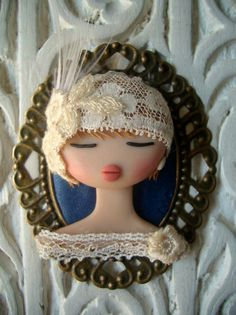 Polymer clay doll brooch with lace Polymer Clay Dolls, Polymer Clay Projects, Polymer Clay Creations, Polymer Clay Jewelry, Clay Crafts, Clay Beads, Clay Earrings, Clay Figurine, Tiny Dolls