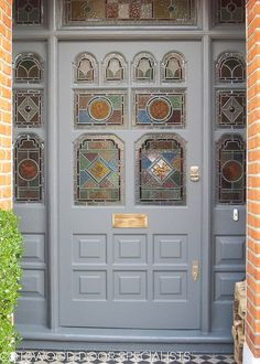 Ornate Victorian front door and frame with stained glass - Cotswood Doors