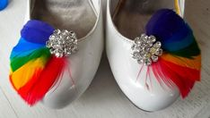 Maybe a simple white or silver show with these on the side of the heel for a pop of color?  Rainbow Shoe Clips  Feathered Shoe Clips  Large by ShoeClipsOnly, $28.00