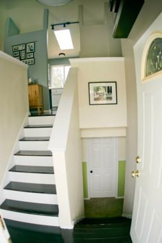Split level entry, a good example of making the most of what you've got.  Take out the old, icky finishes and paint everything a nice light color.  Great.