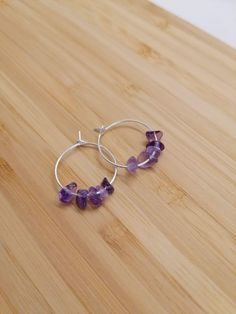 Stunning sterling silver hoops featuring Amethyst gemstone chips. Amethyst is a protective stone, said to protect against negative energies and is used widely to help with stress and anxiety. #handmadejewellery #sterlingsilverjewellery #gemstonejewellery Sterling Silver Hoops, Handmade Sterling Silver, Amethyst Gemstone, Gemstone Jewelry, Gemstone Properties, Anxiety, Chips, Handmade Jewelry, Stress