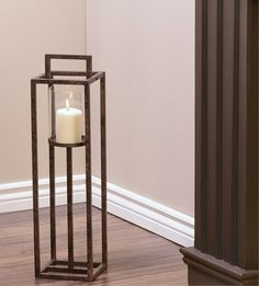 This rectangular tall iron and glass candle holder makes a statement in the home. Whether contemporary, traditional or rustic, these are sure to be a hit. Comes with glass hurricane glass to protect t