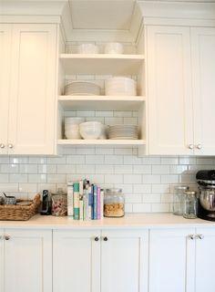 Open shelving between cabinets