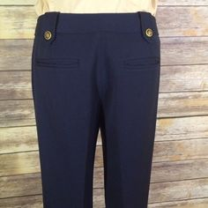 """SALE  ELLEN TRACY navy gold button trouser Ellen Tracy navy trousers with gold accent buttons on belt loops. EUC. Almost perfect new condition. Beautiful soft pant. Drapes nicely. Substantial weight. Unlined. 31"""" inseam. 9"""" front rise. 15"""" rear rise. 15"""" flat across waist at back. Shown on a size 2-4 model. Ellen Tracy Pants Trousers"""
