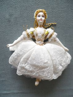 Beautiful hand made doll with hand painted porcelain face,arms,legs,body and beautifull delicate clothes.  Named Ballerina Jacky  Unique gift with perfect details and beautiful colours. White dress with gold color decorations. The doll should be hung.   Height 18 cm/7,09 inch.  See also het sister Ballerina Anna