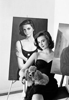Natalie Wood sits with her portrait painted by Margaret Keane.