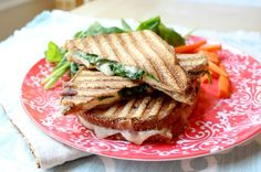This Italian chicken panini comes together in minutes and is perfect for a quick weeknight meal!  Plus it can be made all in one skillet or on a panini press, so cleanup is a breeze! - www.homemadenutrition.com