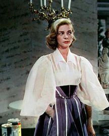 """Not too many woman can pull off this outfit . What an outfit, with amazing balloon sleeves , pleated full skirt with a mitered waist yoke . The costume designer had some real talent.  Bacall, """"Designing Woman"""""""
