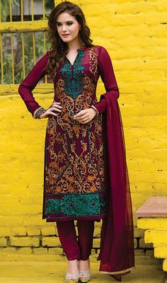 Add a gleam to your looks wearing this pant style suit in maroon color embroidered georgette. The desirable lace and resham work through dress is awe-inspiring. #reshamembroidereddress #latestpantstylesuit #newdesigndresses