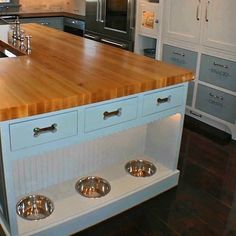 love the dog bowls! dream kitchen and with dog bowls (as if there will ever be dogs in the next house)! Eclectic Kitchen, New Kitchen, Awesome Kitchen, Kitchen Interior, Design Kitchen, Smart Kitchen, Organized Kitchen, Kitchen Storage, Kitchen Floor