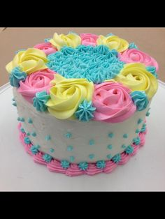 My finale cake!!! Wilton cake decorating course 1 final cake. Swirl flowers. Roses. Star tip. Baby shower cake. Gender reveal cake.