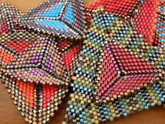 Some of our current peyote triangles, being stacked up for the finished pieces we are putting together.