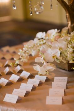 escort card display, white escort cards, crystals and branches, white orchids // Events by Satra // Nicole Ha Designs // Augie Chang Photography
