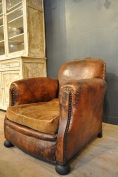 1930 vintage leather club chair...love the warm, worn cognac of this chair...would be great for curling up in and reading a good book on a rainy day... :)