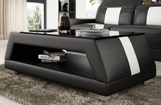 DescriptionUse this leather coffee table to add style and practical functionality to any formal room. A combination of solid wood, glass, and leather makes this contemporary coffee table an attractive piece in any contemporary environment. Genuine Leather Sofa, Modern Leather Sofa, Black Leather, U Shaped Sectional Sofa, Corner Sectional Sofa, Leather Coffee Table, Leather Corner Sofa, Contemporary Coffee Table, Contemporary Furniture