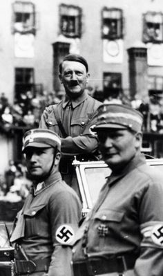 Hitler sporting the SA uniform takes the salute in Nuremberg, 1937. In the foreground Herman Goering also in SA uniform.