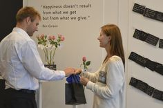 Oliver (from TRULY) giving a rose and gift bag to a happy customer